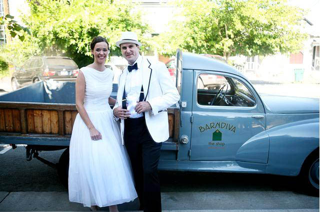 Bride and Groom infront of barn diva truck