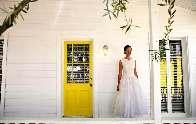 Bride infront of yellow door