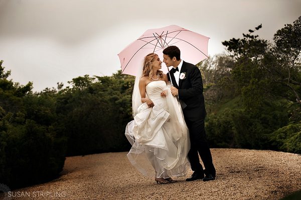 Bride and Groom with pink umbrella