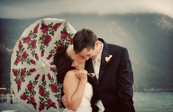 Bride and Groom with rose umbrella