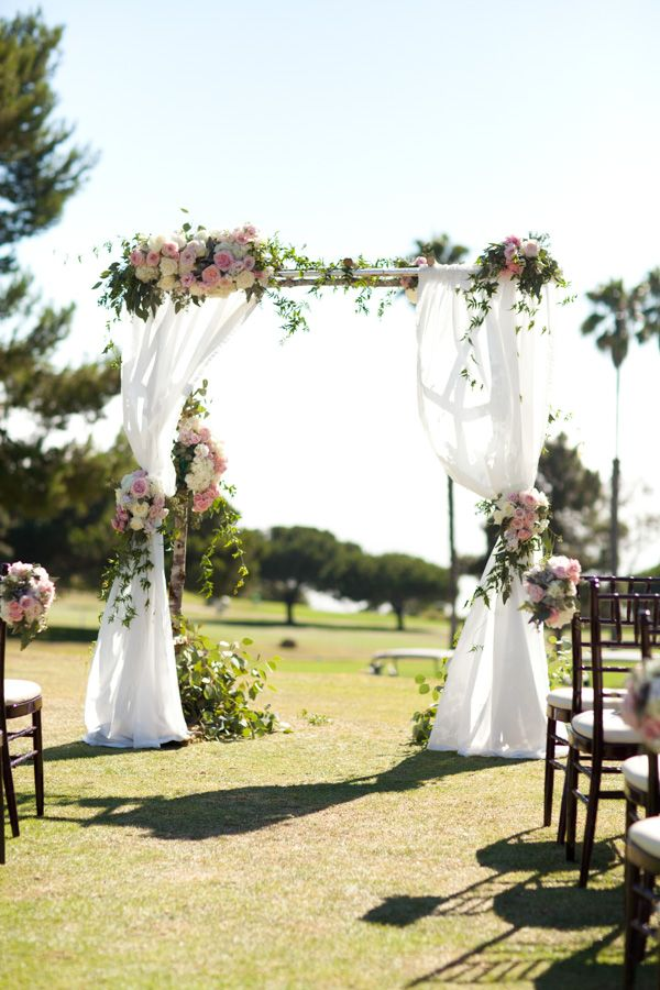 birch arch with chiffon draping and pink flowers - Ultrapom Event Rental